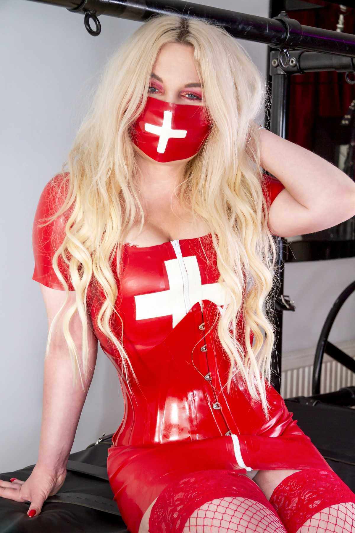medical fetish play Mistress wearing red latex medical outfit